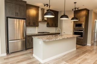 Photo 10: 166 Howse Common in Calgary: Livingston Detached for sale : MLS®# A1143791