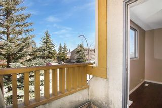 Photo 8: 1433 Ranchlands Road NW in Calgary: Ranchlands Row/Townhouse for sale : MLS®# A1128096