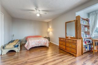 Photo 15: 10 Coach  Manor Rise SW in Calgary: Coach Hill Row/Townhouse for sale : MLS®# A1077472