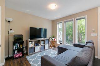 Photo 4: 218 Auburn Bay Square SE in Calgary: Auburn Bay Row/Townhouse for sale : MLS®# A1141951