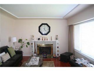 """Photo 2: 2590 E 25TH AV in Vancouver: Renfrew Heights House for sale in """"RENFREW HEIGHTS"""" (Vancouver East)  : MLS®# V1000792"""
