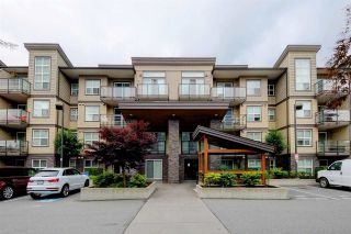 """Photo 1: 410 30515 CARDINAL Avenue in Abbotsford: Abbotsford West Condo for sale in """"Tamarind"""" : MLS®# R2578793"""