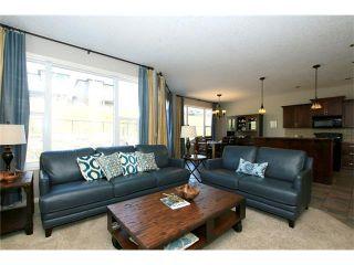 Photo 8: 188 SUNSET Close: Cochrane House for sale : MLS®# C4115906