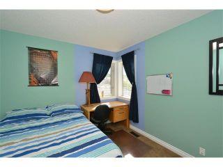 Photo 40: 148 GLENEAGLES Close: Cochrane House for sale : MLS®# C4010996