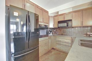 Photo 8: 213 26 VAL GARDENA View SW in Calgary: Springbank Hill Apartment for sale : MLS®# A1095989