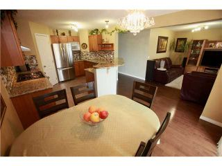 Photo 5: 144 ARBOUR STONE Crescent NW in CALGARY: Arbour Lake Residential Detached Single Family for sale (Calgary)  : MLS®# C3629309
