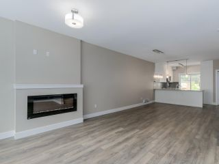 """Photo 12: 401 1405 DAYTON Avenue in Coquitlam: Burke Mountain Townhouse for sale in """"ERICA"""" : MLS®# R2084326"""
