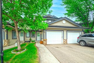 Photo 2: 143 Stonemere Place: Chestermere Row/Townhouse for sale : MLS®# A1132004