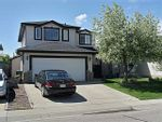Property Photo: 119 WOODSIDE CRES NW in AIRDRIE