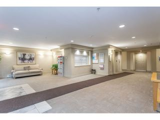 "Photo 3: 412 15220 GUILDFORD Drive in Surrey: Guildford Condo for sale in ""BOULEVARD CLUB"" (North Surrey)  : MLS®# R2531687"