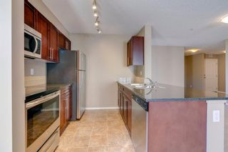 Photo 13: 9302 403 MACKENZIE Way SW: Airdrie Apartment for sale : MLS®# A1032027