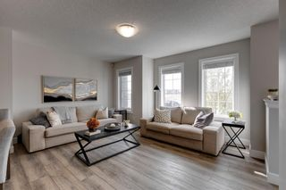 Photo 2: 144 Yorkville Avenue SW in Calgary: Yorkville Row/Townhouse for sale : MLS®# A1145393