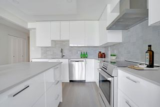 """Photo 8: 405 1490 PENNYFARTHING Drive in Vancouver: False Creek Condo for sale in """"Harbour Cove"""" (Vancouver West)  : MLS®# R2615809"""