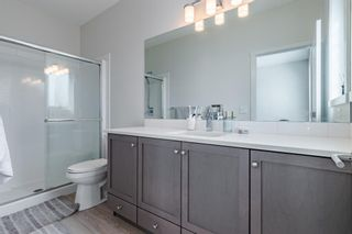 Photo 26: 145 Shawnee Common SW in Calgary: Shawnee Slopes Row/Townhouse for sale : MLS®# A1097036