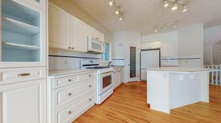 Photo 11: 48 Moreuil Court SW in Calgary: Garrison Woods Detached for sale : MLS®# A1075333