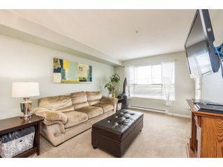 """Photo 5: 313 5465 203 Street in Langley: Langley City Condo for sale in """"STATION 54"""" : MLS®# R2206615"""