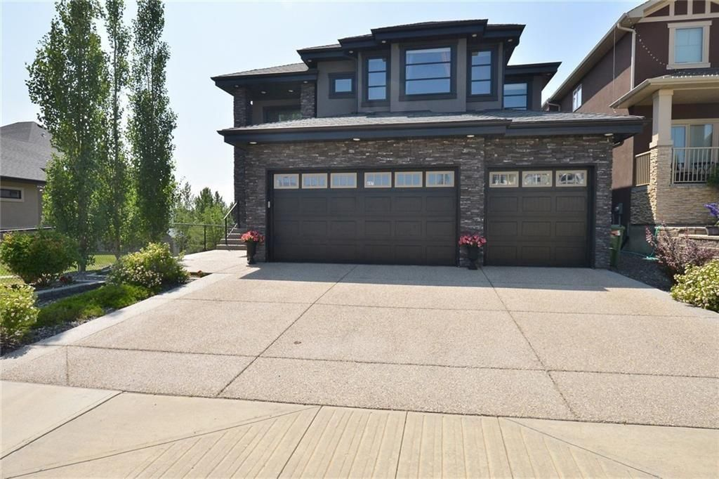 Main Photo: 697 TUSCANY SPRINGS Boulevard NW in Calgary: Tuscany Detached for sale : MLS®# A1060488