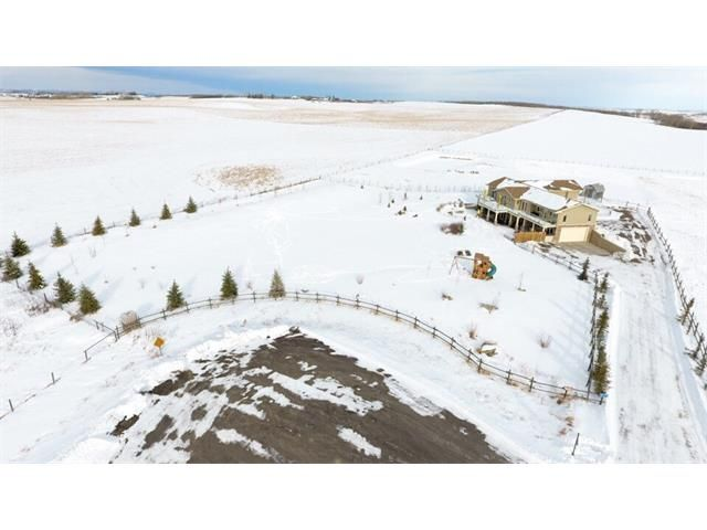your 3+- acre home property line actually goes to the next fenceline and includes a dugout for those winter hockey games.