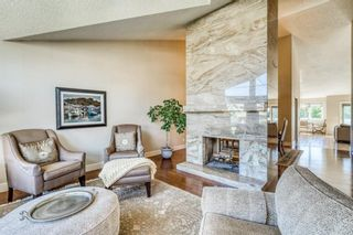 Photo 7: 555 Coach Light Bay SW in Calgary: Coach Hill Detached for sale : MLS®# A1144688