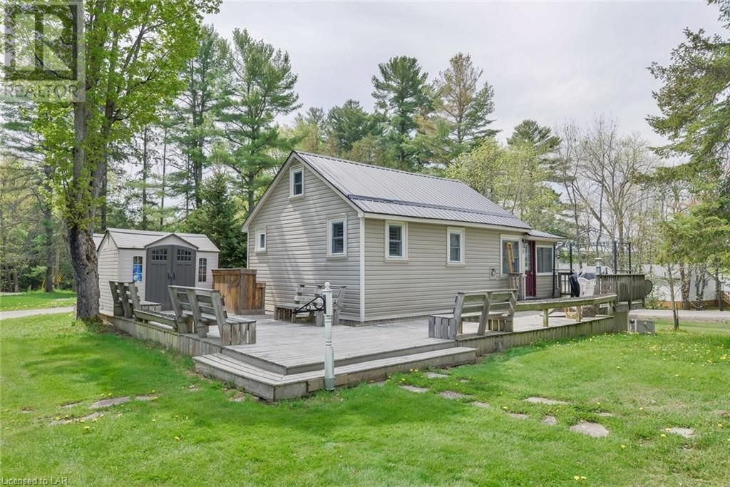 Main Photo: 1168 MOON RIVER Road Unit# Cottage 6 in Bala: House for sale : MLS®# 40124974