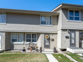 Photo 2: 55 123 Queensland Drive SE in Calgary: Queensland Row/Townhouse for sale : MLS®# A1101736