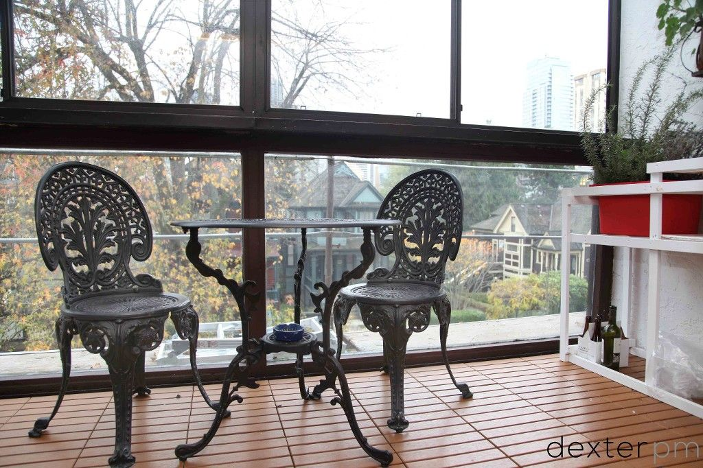 Enclosed balcony - eating nook or great office space.