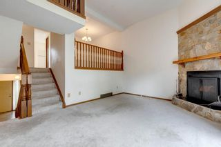 Photo 2: 100 23 Glamis Drive SW in Calgary: Glamorgan Row/Townhouse for sale : MLS®# A1056750