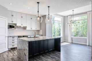 Photo 10: 53 Crestmont Drive SW in Calgary: Crestmont Detached for sale : MLS®# A1118575