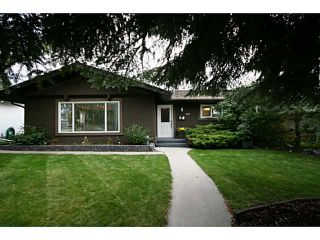 Photo 1: 1151 LAKE WAPTA Road SE in Calgary: Lake Bonavista Residential Detached Single Family for sale : MLS®# C3637144