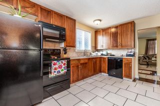 Photo 2: 386 2211 19 Street NE in Calgary: Vista Heights Row/Townhouse for sale : MLS®# A1149478