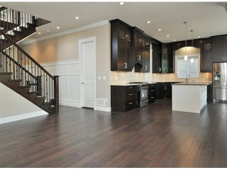 """Photo 7: 16951 79TH Avenue in Surrey: Fleetwood Tynehead House for sale in """"THE LINKS"""" : MLS®# F1412362"""