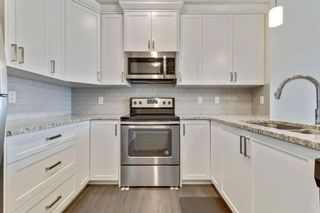 Photo 10: 333 Heartland Crescent: Cochrane Semi Detached for sale : MLS®# A1063240
