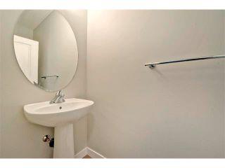 Photo 16: 140 FIRESIDE Place: Cochrane House for sale : MLS®# C4013130