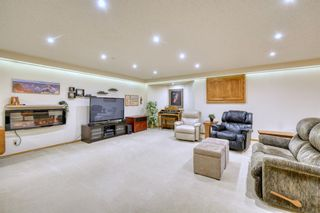 Photo 37: 20A Woodmeadow Close SW in Calgary: Woodlands Row/Townhouse for sale : MLS®# A1127050