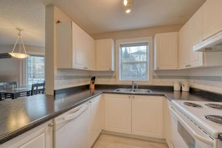 Photo 7: 113 9 Country Village Bay NE in Calgary: Country Hills Village Apartment for sale : MLS®# A1052819