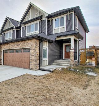 Photo 2: 199 Kinniburgh Road: Chestermere Semi Detached for sale : MLS®# A1082430