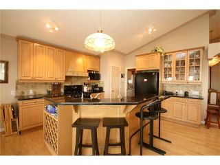 Photo 15: 313 GLENEAGLES View: Cochrane House for sale : MLS®# C4047766
