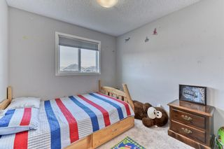 Photo 19: 203 River Heights Green: Cochrane Detached for sale : MLS®# A1145200