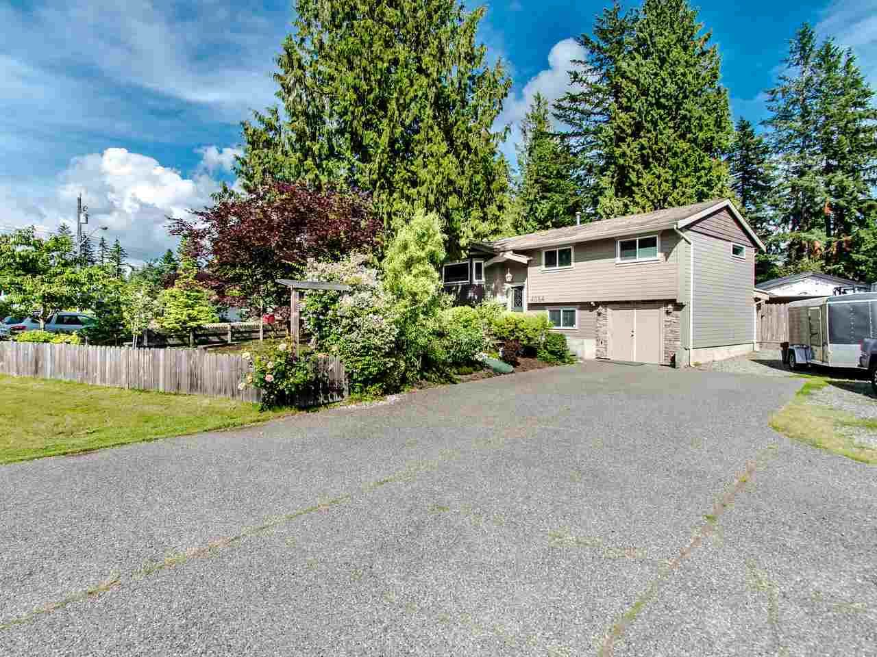 "Main Photo: 4084 202A Street in Langley: Brookswood Langley House for sale in ""BROOKSWOOD"" : MLS®# R2465158"