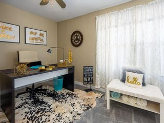 Photo 17: 55 123 Queensland Drive SE in Calgary: Queensland Row/Townhouse for sale : MLS®# A1101736