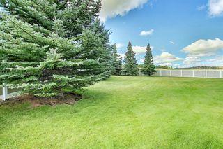 Photo 34: 33 200 Hidden Hills Terrace NW in Calgary: Hidden Valley Row/Townhouse for sale : MLS®# A1141008