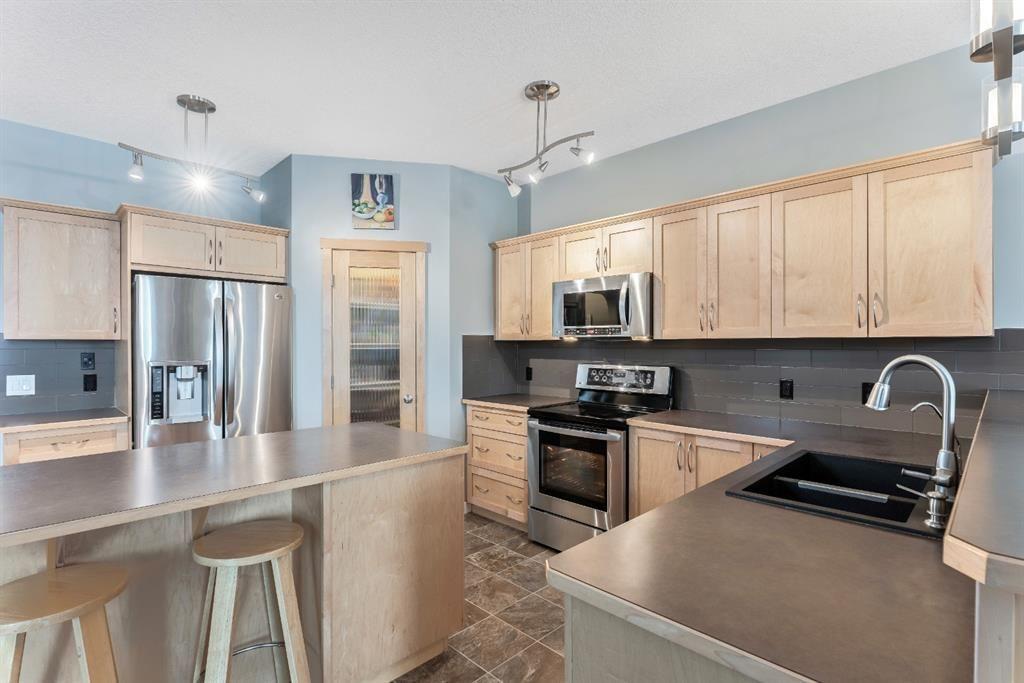 Photo 12: Photos: 434 Boulder Creek Drive SE: Langdon Detached for sale : MLS®# A1066594