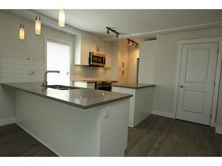 """Photo 5: 101 218 BEGIN Street in Coquitlam: Maillardville House for sale in """"BEGIN SQUARE"""" : MLS®# V1132326"""
