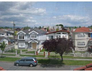 Photo 9: 6311 BRUCE Street in Vancouver: Killarney VE House for sale (Vancouver East)  : MLS®# V653313