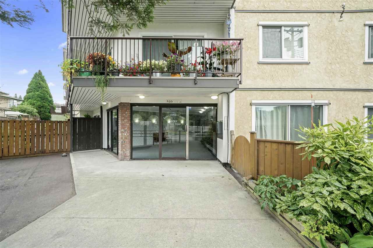 "Main Photo: 105 630 CLARKE Road in Coquitlam: Coquitlam West Condo for sale in ""King Charles Court"" : MLS®# R2534603"