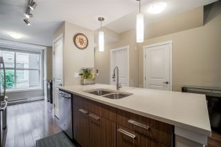 "Photo 6: 216 2110 ROWLAND Street in Port Coquitlam: Central Pt Coquitlam Townhouse for sale in ""Aviva On The Park"" : MLS®# R2466337"