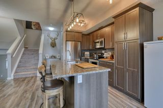 Photo 6: 643 101 Sunset Drive N: Cochrane Row/Townhouse for sale : MLS®# A1117436