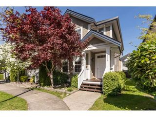 """Photo 1: 6968 179A Street in Surrey: Cloverdale BC Condo for sale in """"The Terraces"""" (Cloverdale)  : MLS®# R2364563"""