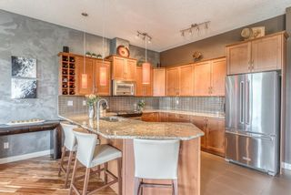 Photo 6: 408 35 Aspenmont Heights SW in Calgary: Aspen Woods Apartment for sale : MLS®# A1149292