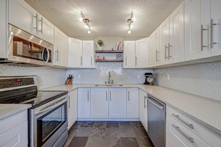 Photo 2: 401 9930 Bonaventure Drive SE in Calgary: Willow Park Row/Townhouse for sale : MLS®# A1097476